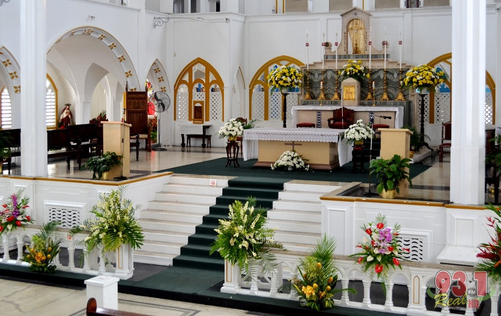 The main altar of the cathedral is decorated with glowing colours under a yellow and white theme.