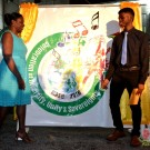 Minister Henry and the winner of the 2016 theme for Mashramani celebrations