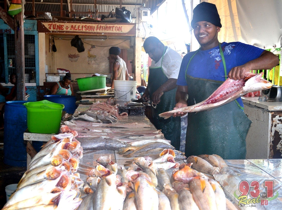 """Cleaning a """"trout"""". Fish is sold daily at this section of the Bourda Market,close to the Regent Street entrances"""