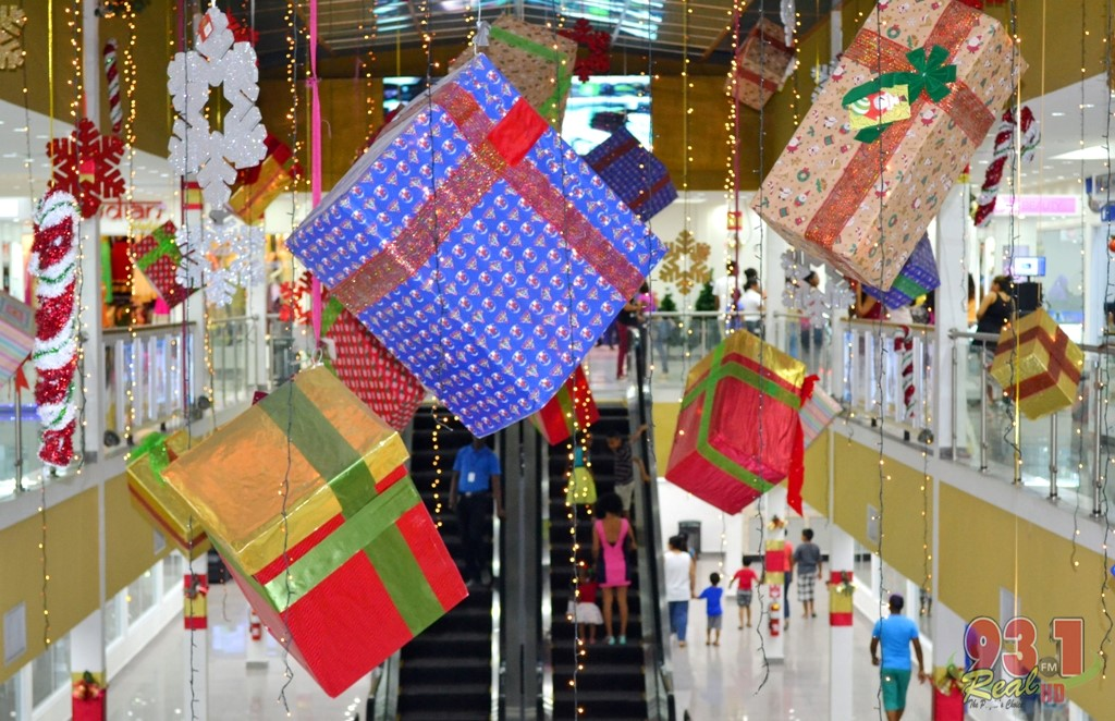 the interior of the mall well decorated with hanging gifts and other christmas decorations - Mall Christmas Decorations