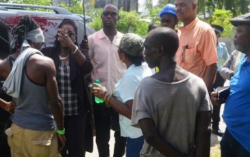 Minister in the Ministry of Communities, Valerie Sharpe- Patterson interacts with residents